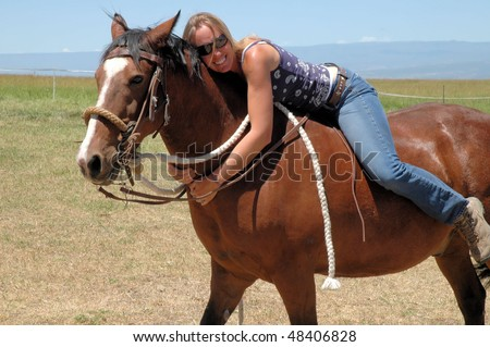 Woman sitting on horse bareback