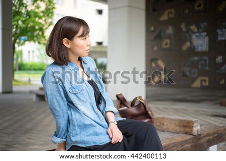Woman sitting on outdoor bench