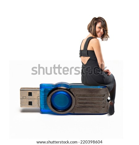 Woman sitting on pendrive over white background
