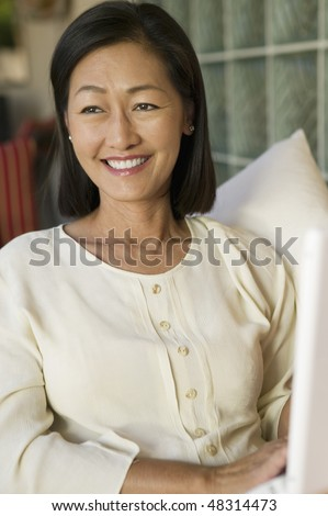 Woman Sitting on Sofa - stock photo