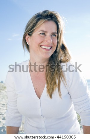Woman sitting on the beach on a sunny day