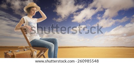 woman sitting on the chair in the desert