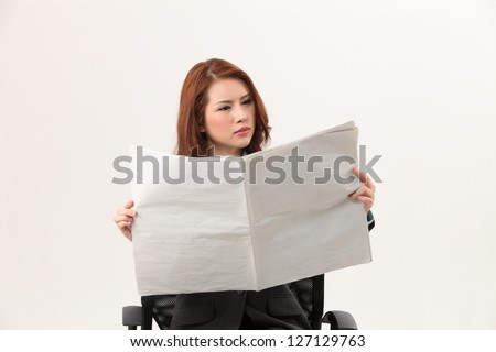 woman sitting on the chair reading paper