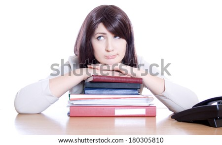 Woman sitting on the heap of files - thinking (white background). - stock photo
