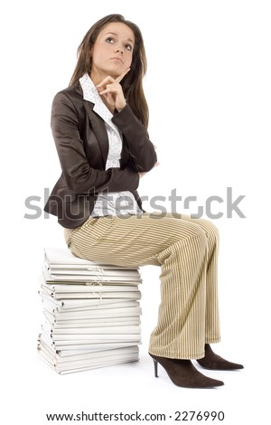 woman sitting on the heap of files - thinking  (white background) - stock photo