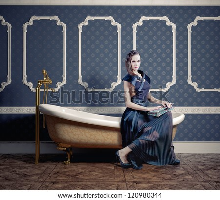 woman , sitting on the vintage bathtub - stock photo