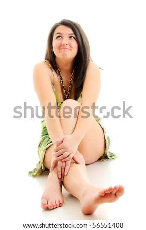 Woman sitting on white floor. Focused on hands. - stock photo