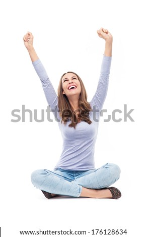 Woman sitting with arms raised   - stock photo