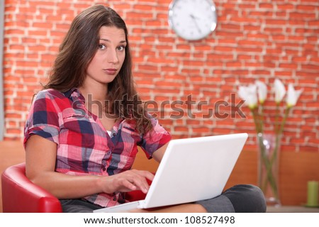 woman sitting with computer - stock photo