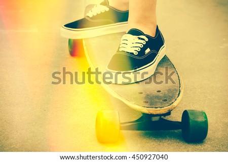 Woman skateboarding with light leaks - stock photo