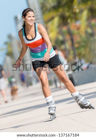 Woman skating outdoors by the beach in Miami - stock photo