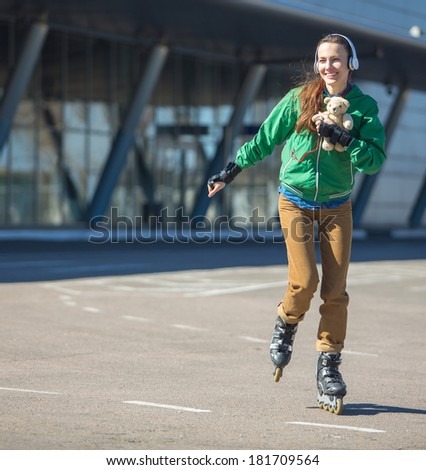 woman skating with rollerblades in a park on a sunny day - stock photo