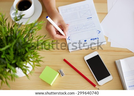 Woman sketching on paper web design - stock photo