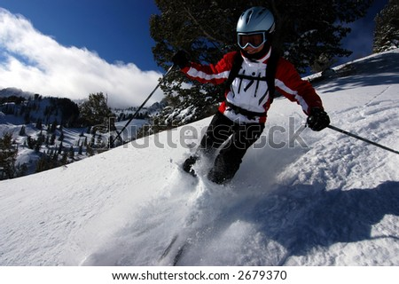 Woman skiing fresh powder in a Utah resort - stock photo