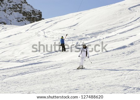 woman skiing in the mountains - stock photo