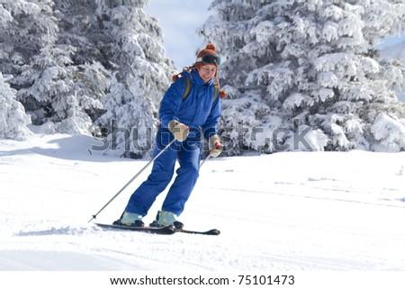 woman skiing on empty ski slope - stock photo