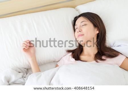 Woman sleep on bed - stock photo