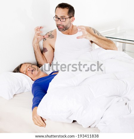 woman sleeping and man being upset - stock photo