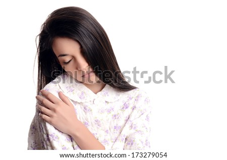 Woman sleeping. Beautiful girl in pajamas falling asleep. Isolated on white background.
