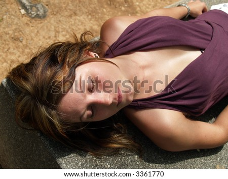 Woman sleeping in a bench