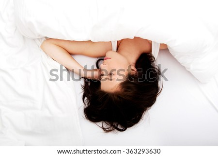 Woman sleeping in bed. - stock photo