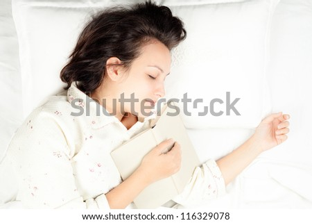 Woman Sleeping in Bed with Book