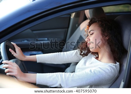 Woman sleeping in car - stock photo