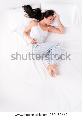 Woman sleeping in open fetal position