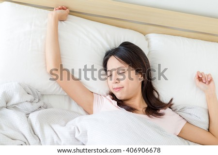Woman sleeping on bed - stock photo