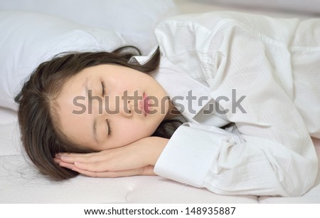 woman sleeping on her bed at home