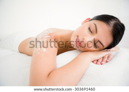 Woman sleeping with salt scrub on the back at the health spa
