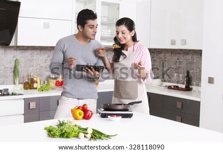 Woman smelling her cooking - stock photo