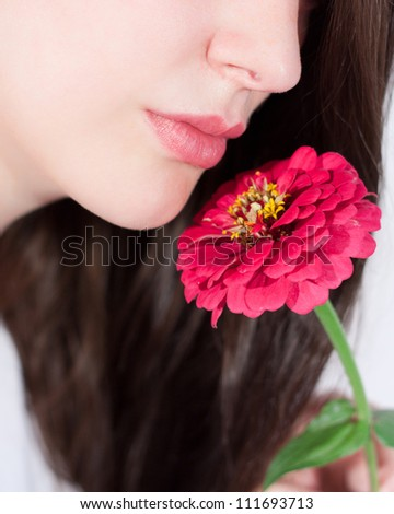Woman smelling the fragrance of a flower