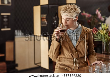 Woman smelling the rich aroma of fresh morning coffee - stock photo