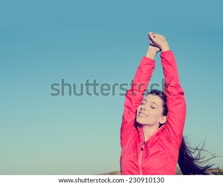 Woman smiling arms raised up to blue sky, celebrating freedom. Positive human emotions, face expression feeling life perception success, peace of mind concept. Free Happy girl on beach enjoying nature - stock photo