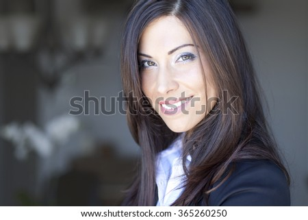 Woman Smiling At The Camera - stock photo