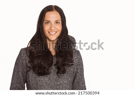Woman smiling at the camera on a white background