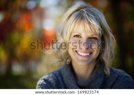 Woman smiling at the park - stock photo