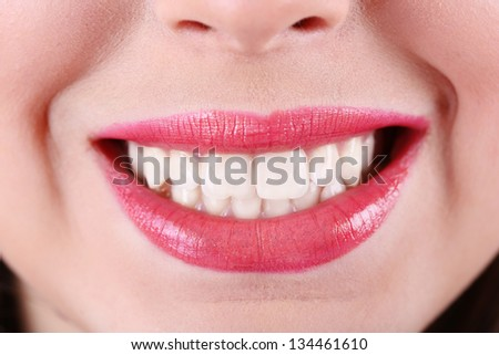 Woman smiling, close up