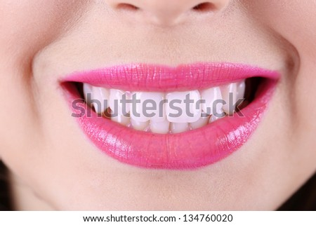 Woman smiling, close up - stock photo
