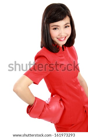 Woman smiling happy wearing red boxing gloves isolated on white background