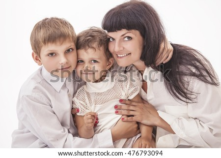 Woman smiling mother that kissing kids boy and girl