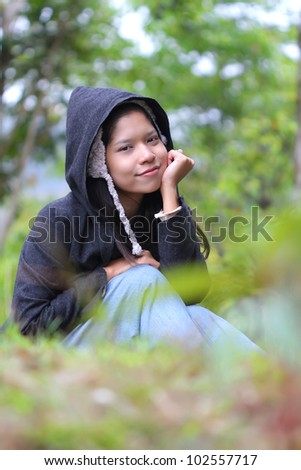 Woman smiling outside in forest