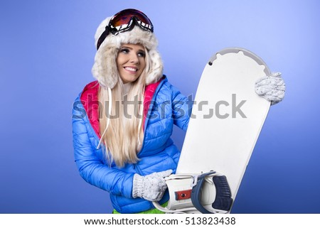 Woman smiling skier girl wearing fur vest ski googles. Winter sport activity