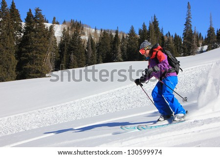 Woman smiling while downhill skiing, Utah, USA. - stock photo