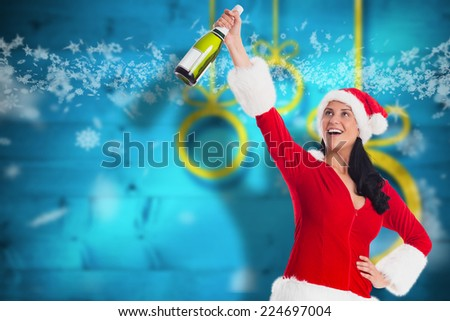 Woman smiling with christmas presents against blurred christmas background - stock photo