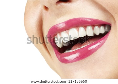 Woman smiling with great teeth on white background . Laughing woman with pink lips