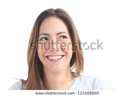 Woman smiling with her eyes looking at side on a white isolated background - stock photo