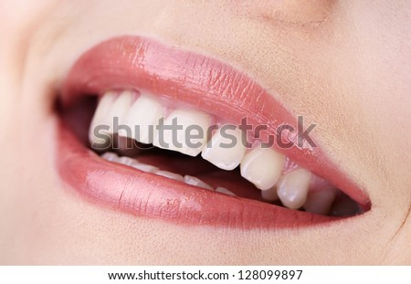 Woman smiling with teeth isolated on white background