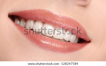 Woman smiling with teeth isolated on white background - stock photo